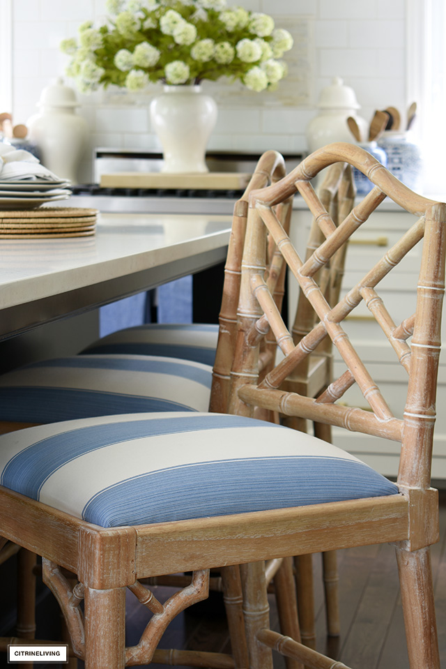 Chic blue and white striped fabric covers this kitchen bar stool seat.
