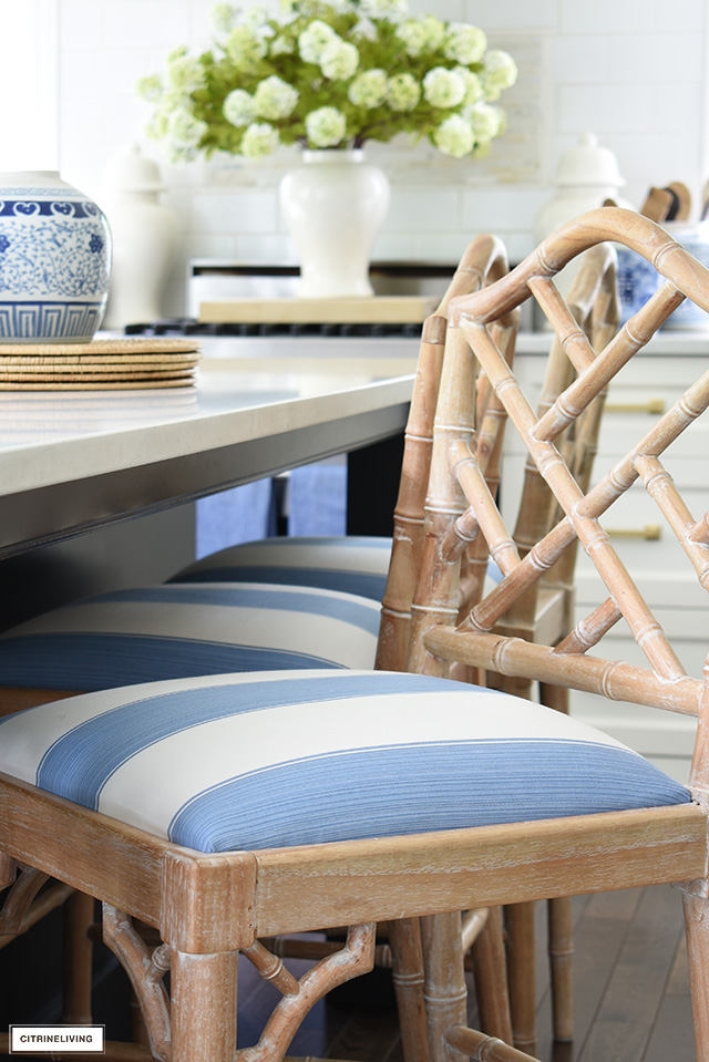 Bar stool recovered with blue and white striped fabric by Kravet.