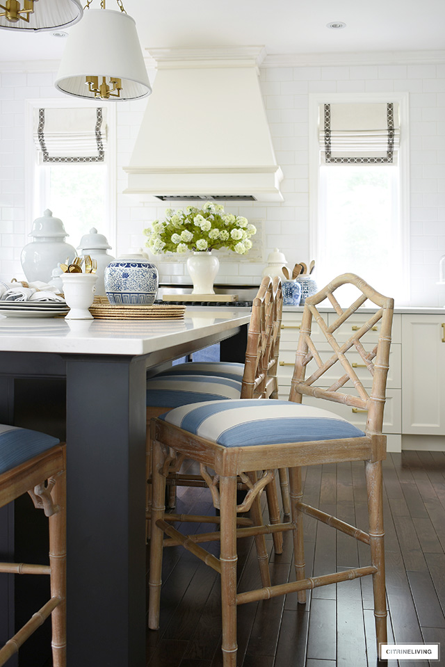 Beautiful kitchen bar stools with a chinoiserie chic look and blue and white seat fabric by Kravet.