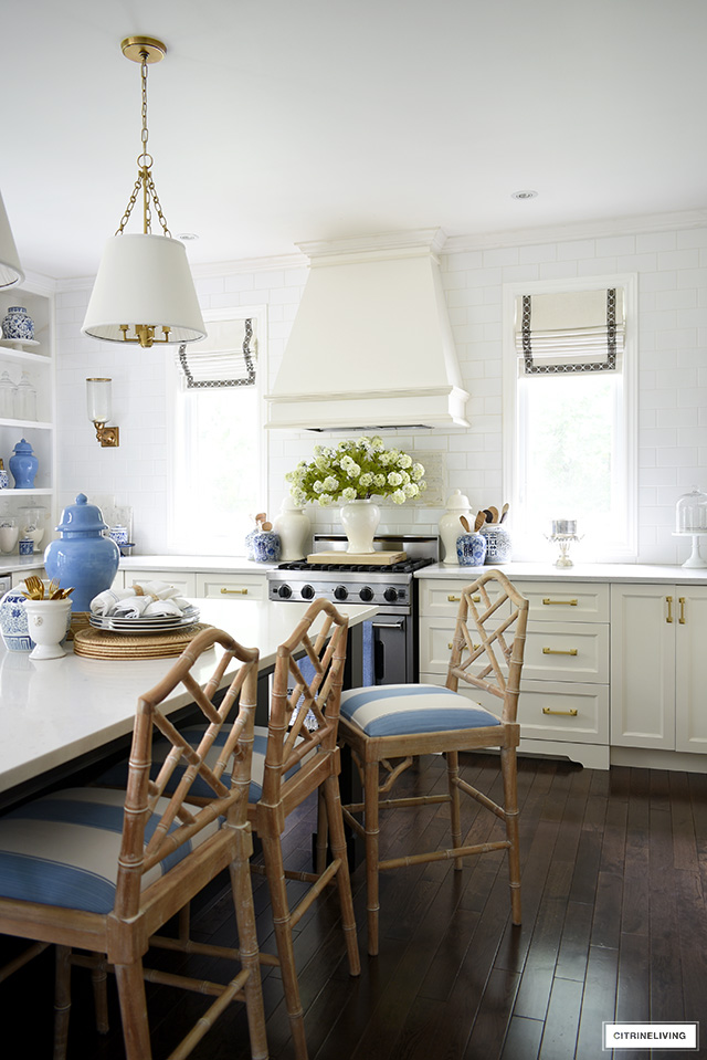 Kitchen decorated for summer with beautiful blue and white accents, faux florals and ginger jars.