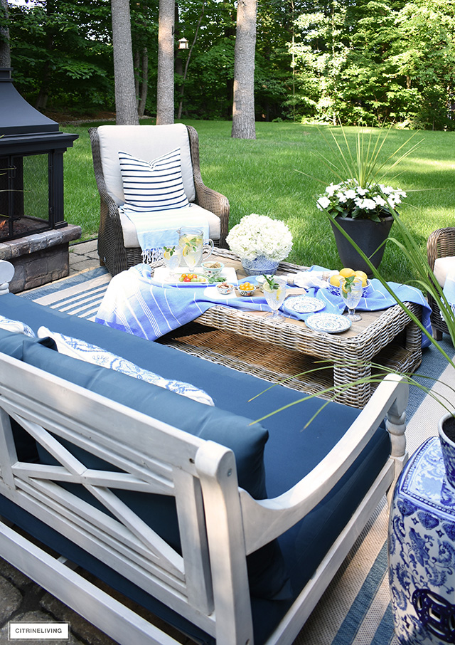 Outdoor summer entertaining with a beautiful tablescape.