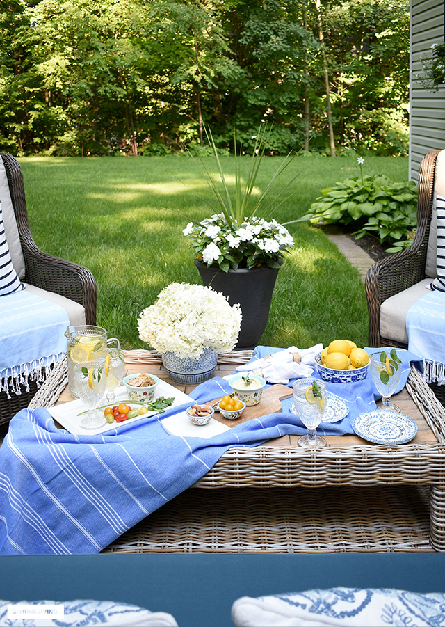 Backyard setting with a beautifully styled tablescape for casual dining.