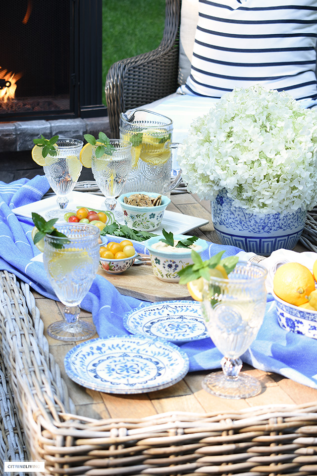 Causal tablescape styled for summer outdoor entertaining.