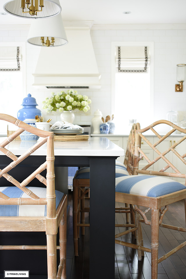 Chinese chippendale style kitchen bar stools with blue and white striped fabric.