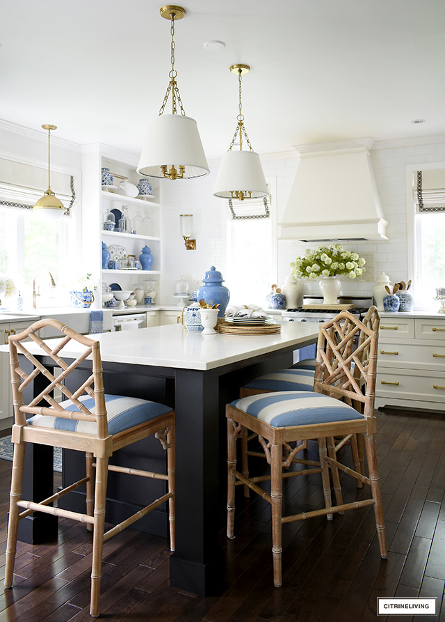 Summer kitchen decorated with beautiful blue and white accents and faux florals.