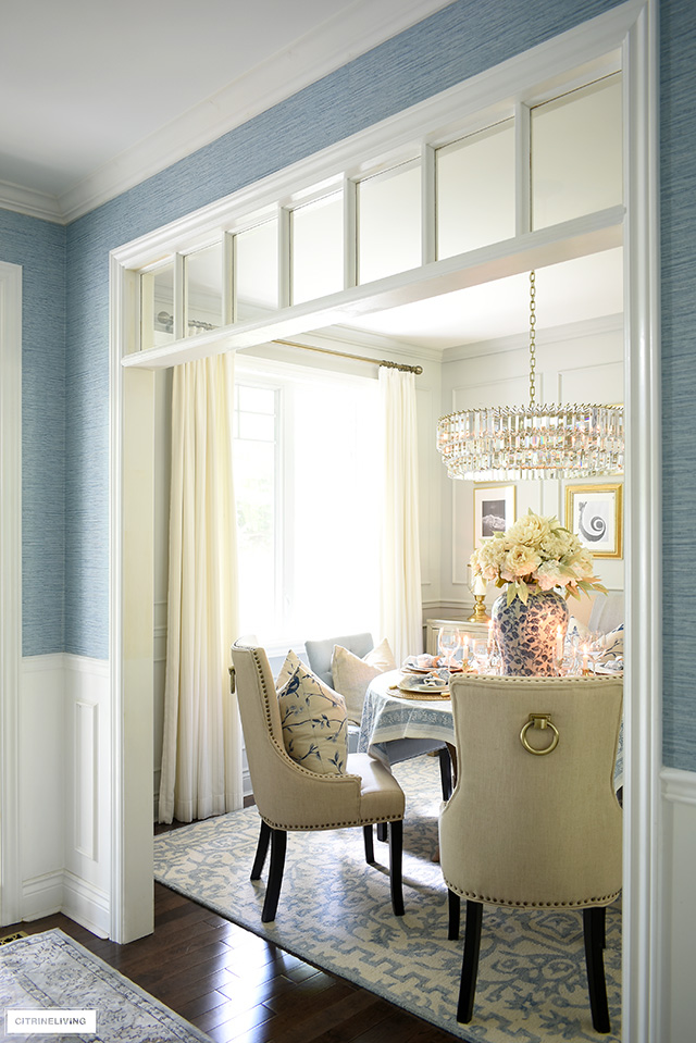 View into a dining room with neutral and soft blue decor.