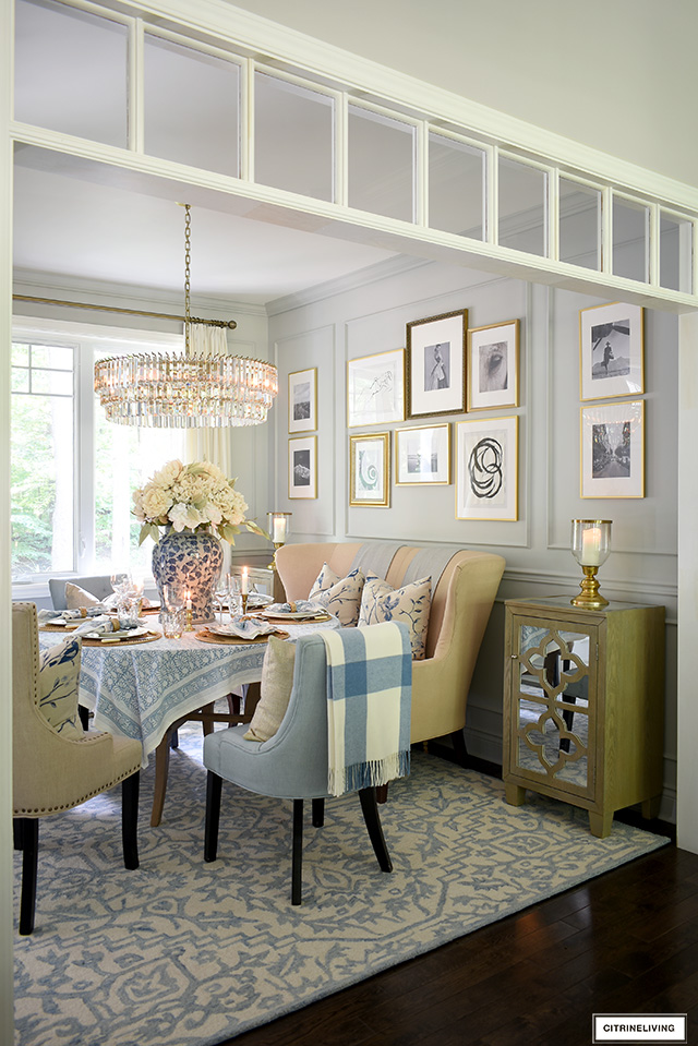 Fall dining room decor featuring a soft blue and warm neutral color palette.