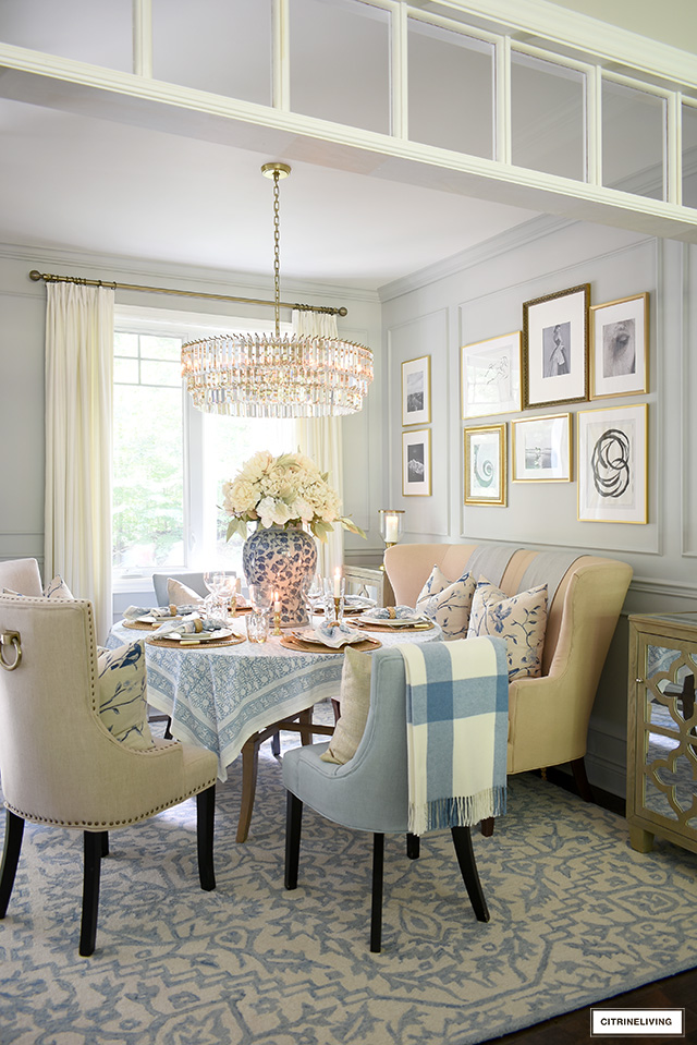 Dining room decorated for fall with a soft blue and neutral color palette.