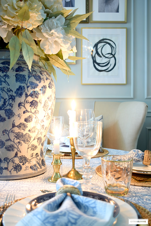 Beautiful candlelit fall tablescape in blue and white with gold accents.