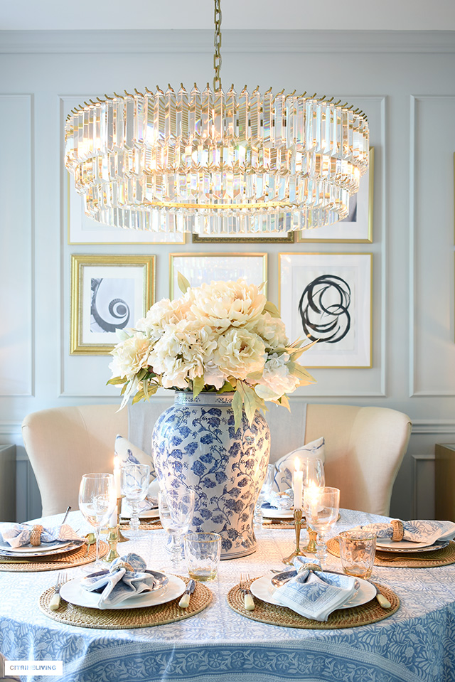 Fall tablescape layered with soft blues, natural woven elements and neutral tones.