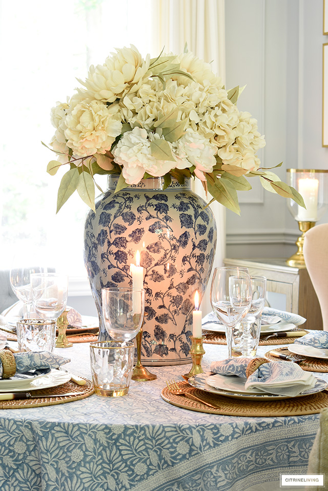 Fall floral arrangement with beige hydrangeas, peonies and muted green leaves.