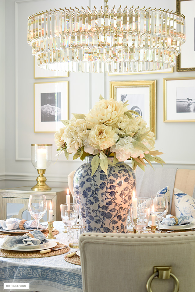 Fall centrepiece with large ginger jar and faux hydrangeas, peonies and greenery in soft, muted colors.