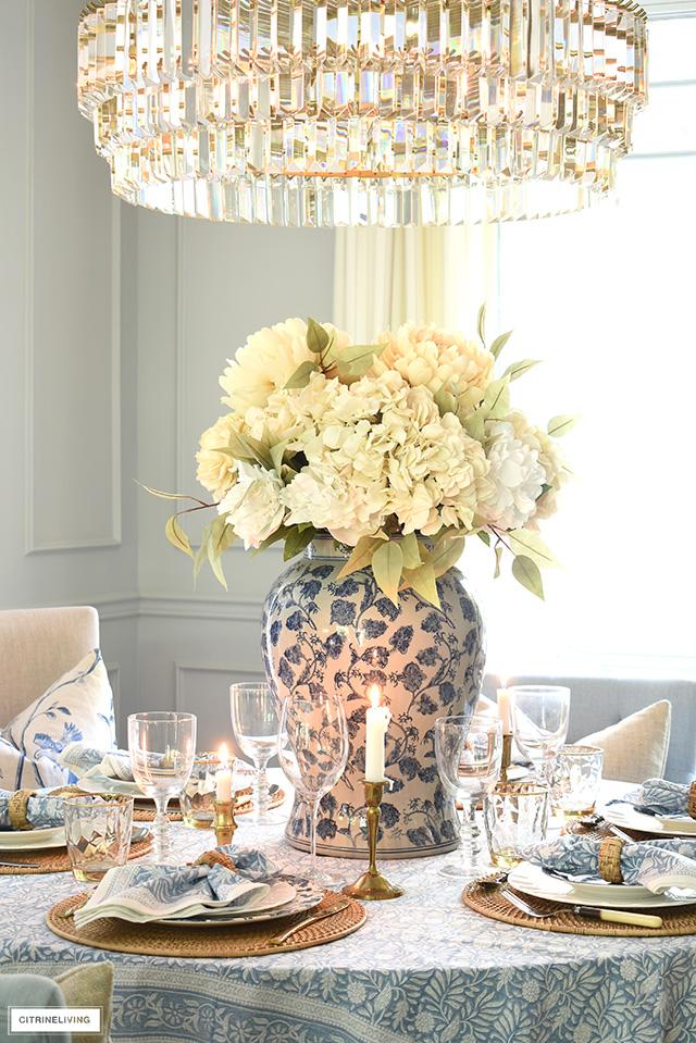 Faux floral arrangement in soft neutrals is a gorgeous fall centrepiece.