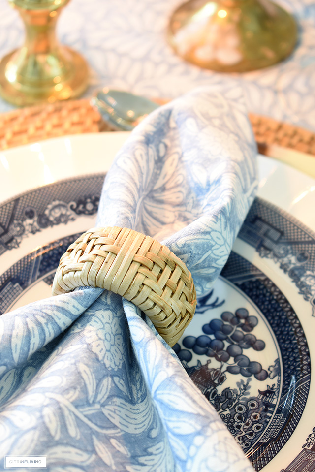 Can napkin ring, block print napkin and blue willow dishes create a beautiful fall table setting.