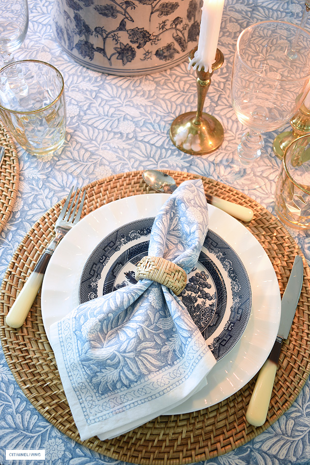 Fall tablescape with woven placemats, chinoiserie dishes and ginger jar, and block print linens.