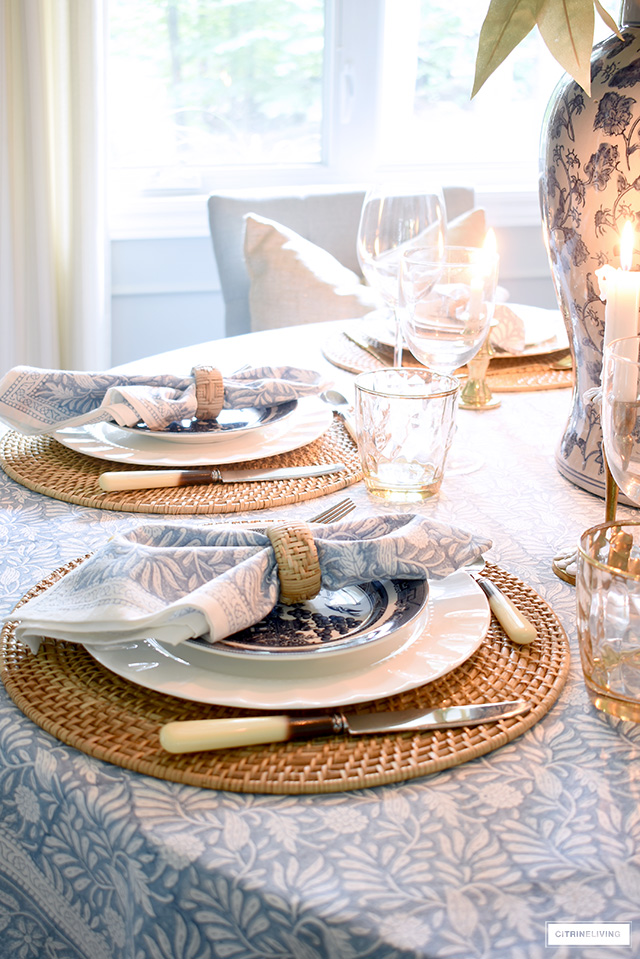 Table setting for fall with block print blue linens and woven placemat.