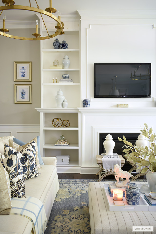 Bookshelves styled for fall with simple seasonal accents.