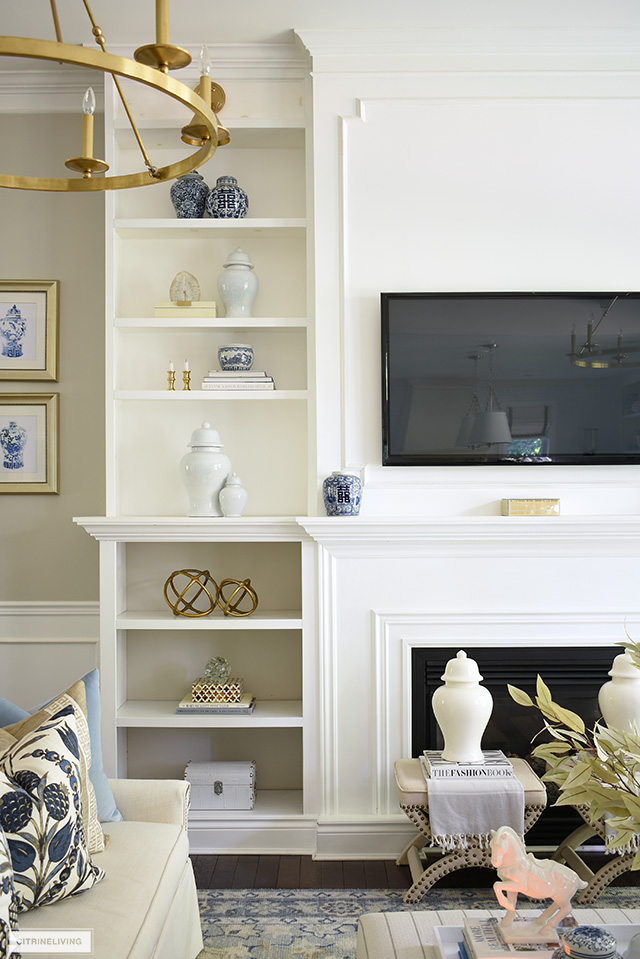 Beautiful and elegant fall styling on bookshelves with ginger jars and simple seasonal accents.