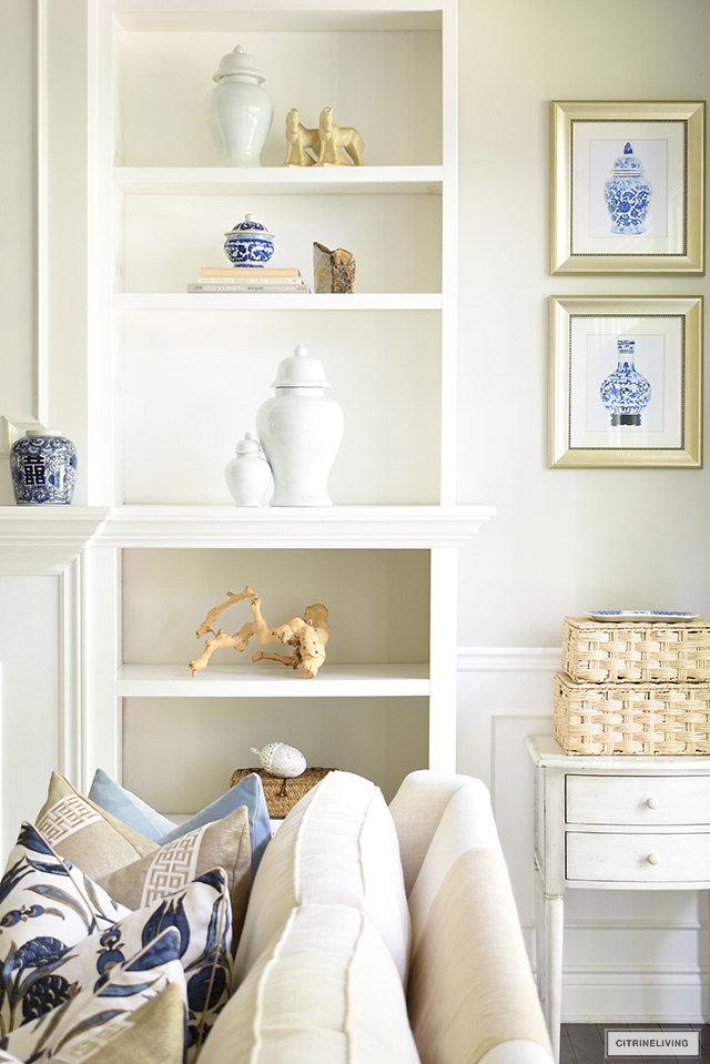 Bookshelf styling with ginger jars, drift wood sculpture and simple accories.