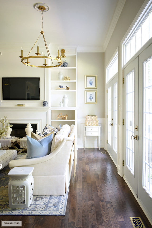 Living room view decorated for fall with simple seasonal accessories.