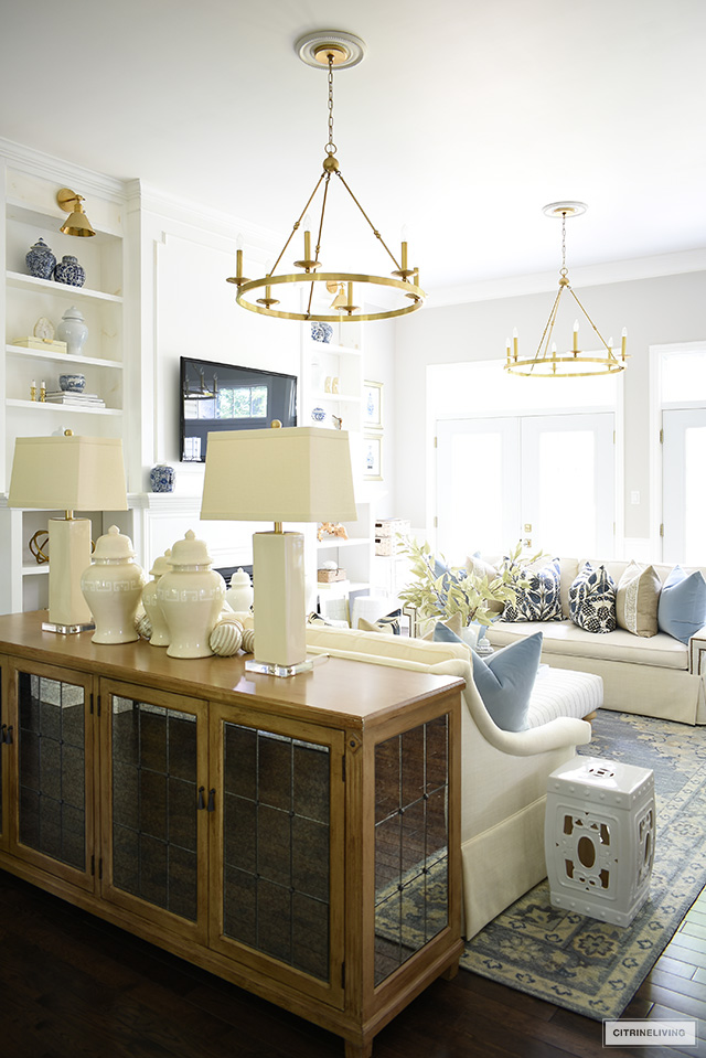 Living room styled for fall in a beautiful blue and warm neutral color palette.