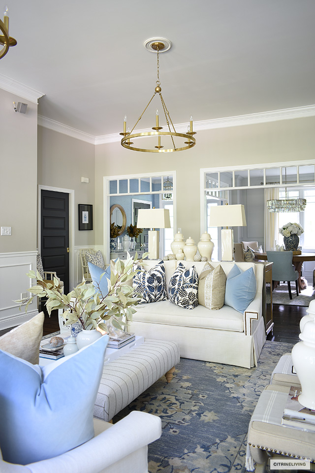 Living room decorated for fall with gorgeous blue and warm neutral color palette and simple seasonal accessories.