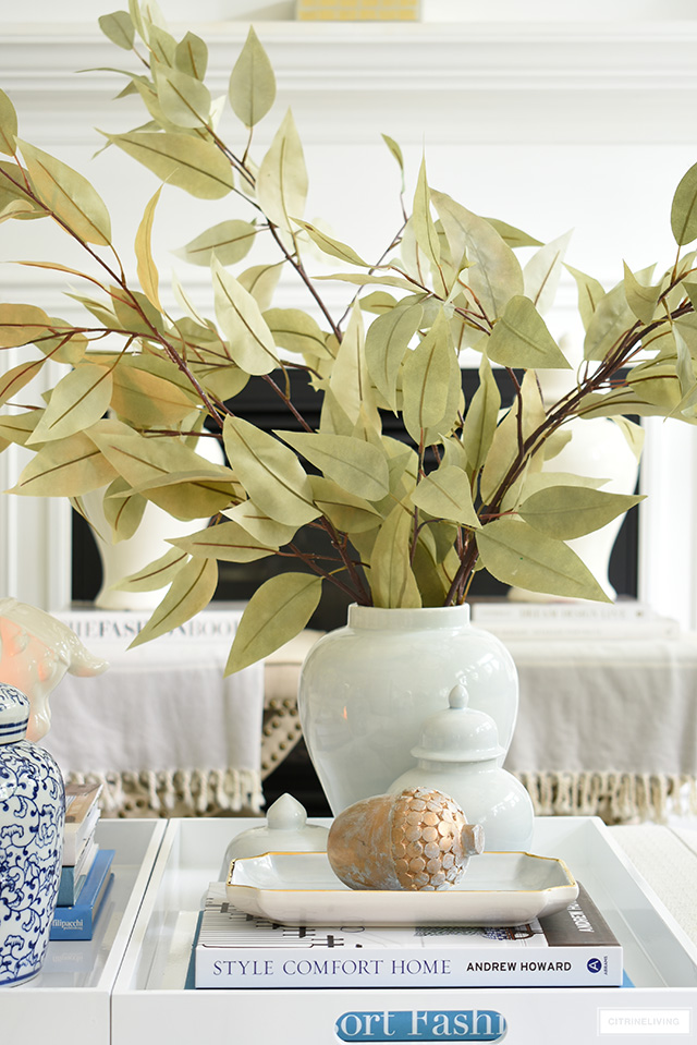 Beautiful fall styling with ginger jars, faux leaves and simple seasonal accessories.