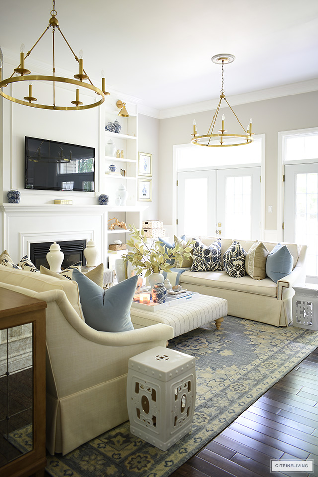 Fall living room decorated with blues and warm neutrals and gold accents.