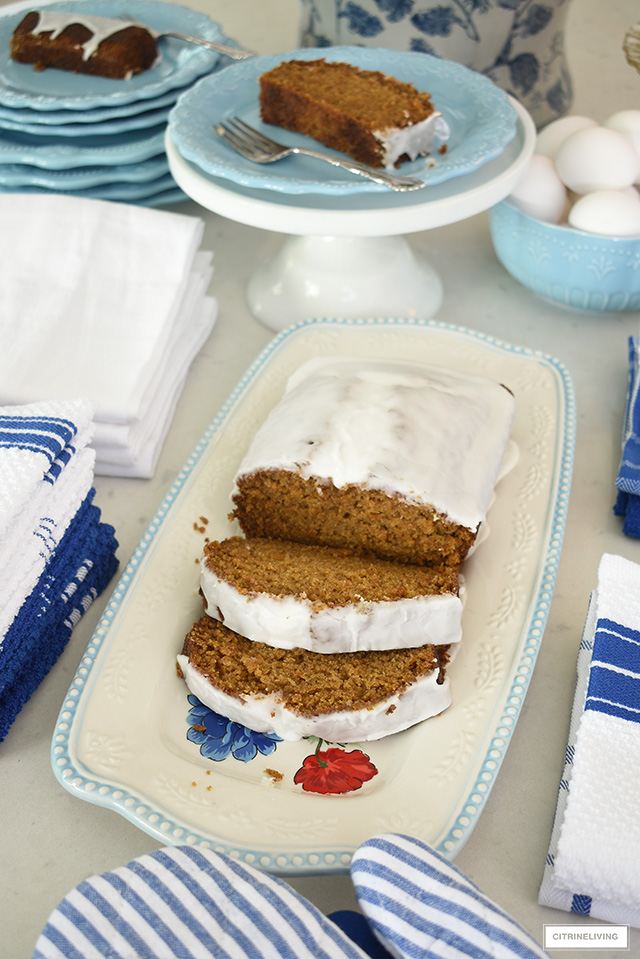 Pioneer Woman dishes and platter featuring a yummy pumpkin loaf with glaze.