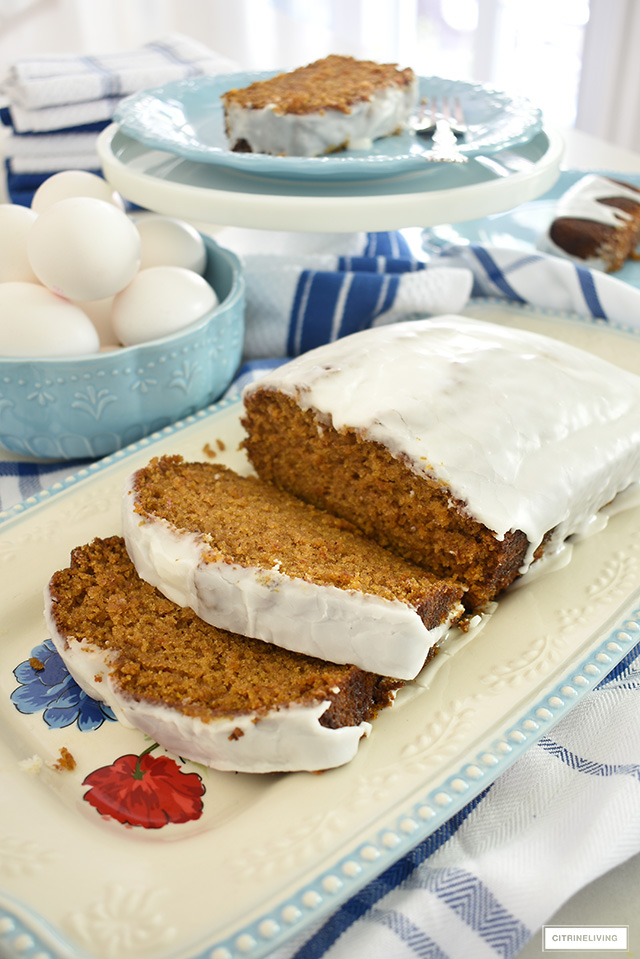 Delicious pumpkin loaf with glaze styled on a beautiful platter.