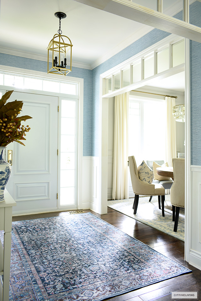 Entryway decorated with a beautiful navy blue bohemian inspired rug.