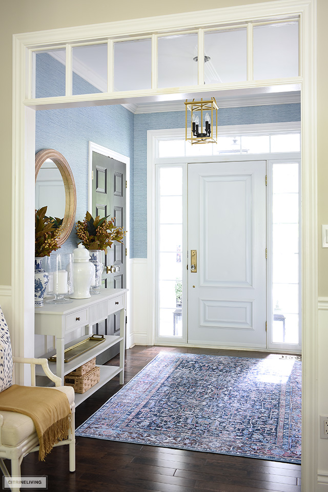 fall entryway decor with a beautiful navy blue rug and simple seasonal touches.