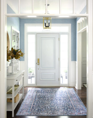 Fall entryway decor in blues, a navy blue bohemian-inspired rug and simple fall touches.