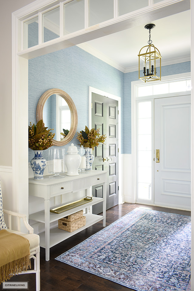 Entryway decorated for fall with beautiful deep blues and rich gold tones.